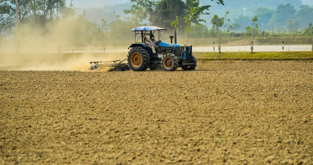 Land preparation with tractor, Tractor plows a field, agriculture modern method