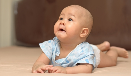 Innocent baby on bed  very cute