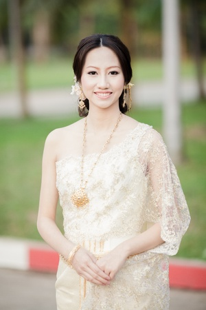 Beautiful asian with welcome expression, Thai girl with Thai dress