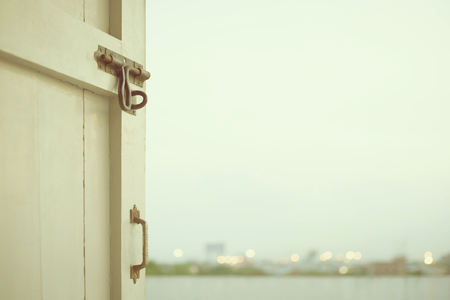 keys to heaven: The door that open to the outside. (selective focus on a hasp, vintage style)