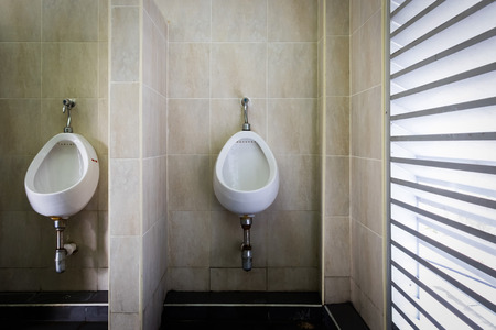 public restroom: Urinals in public toilet. public restroom for men. Stock Photo