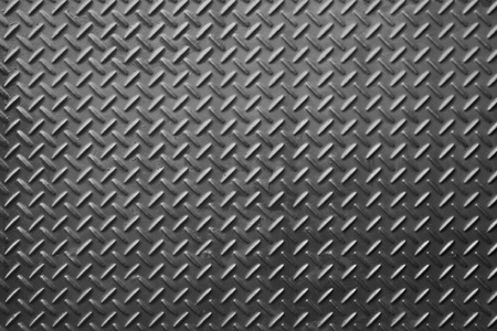 rustproof: Metal diamond plate or old checkered steel plate with rustproof coating well. background. texture. Stock Photo