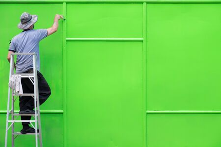 building wall: A man painted steel wall. Green wall.