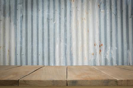 metal sheet: Wooden floor with old metal sheet roof texture. Pattern of old metal sheet. Metal sheet texture. Rusty metal sheet texture. Stock Photo