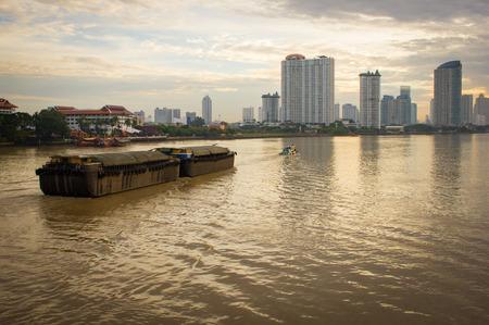 towed: View of the Chao-Phraya-River at dawn. Bangkok, Thailand Stock Photo