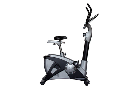 Upright bike for exercise in gym or fitness isolated on white background with clipping path. Stock Photo