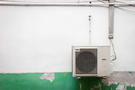 Old ventilators of air conditioning It is mounted on the outside wall. Energy-saving ideas.