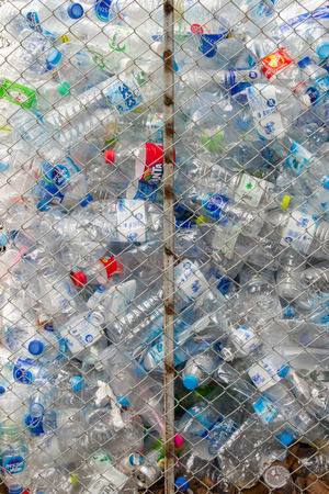 BANGKOK, THAILAND - AUGUST 5: Rama 2 Road on August 5, 2018 in Bangkok, Plastic bottles are stored in grids waiting to be recycled. Bangkok, Thailand.