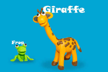 Statues like cute animals for children, like children's toys. Molding from plasticine to enhance children's learning skills. Cartoon characters, frogs and giraffes isolated on blue background.
