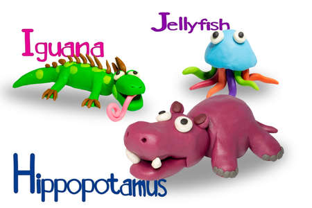 Statues like cute animals for children. Molding from plasticine to enhance children's learning skills. Cartoon characters, Iguana, Jellyfish and Hippopotamus isolated on white background. 免版税图像