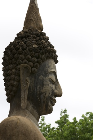Buddha head sculpture. Side in the old days photo