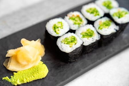 Rolls of rice, nori and cucumber. Japanese cuisine. Ginger and wasabi
