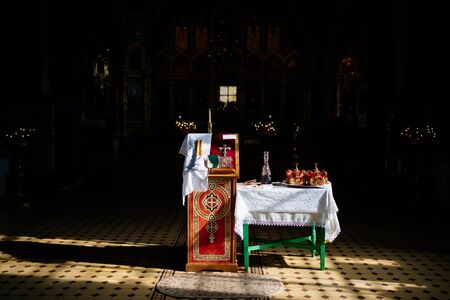 items for the sacrament of wedding on the table and ambo in the Church. biblical and Orthodox cross.