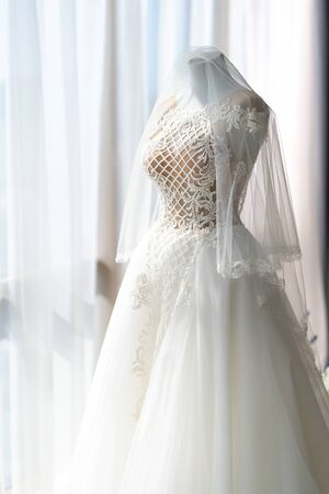 wedding dress on a mannequin in the panorama window. the morning before the ceremony.