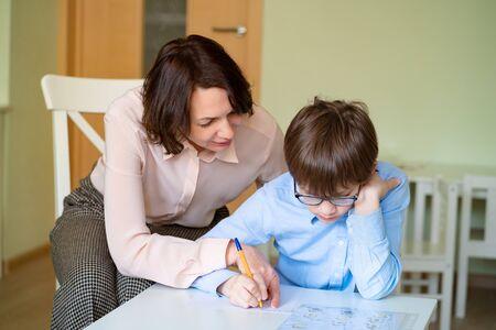 mom helps son to do homework. the teacher deals with a boy.