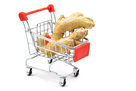 the ginger root in the toy shopping cart. increased immunity. isolated on white background.