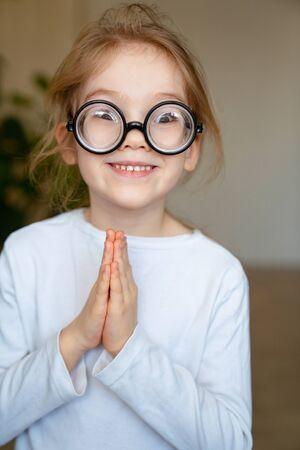 funny little blonde girl round glasses black rimmed smile.