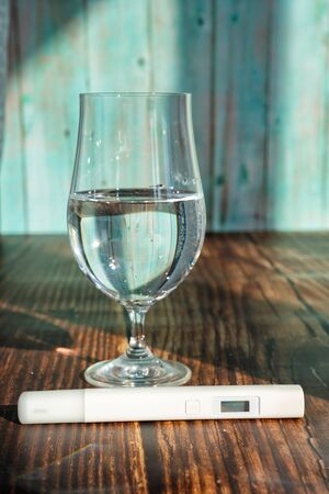 TDS meter to determine of drinking water. purification and filtering contaminants. Stock Photo