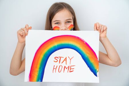 blond teen girl with hair drew a rainbow and a poster stay home. flashmob chasetherainbow. 写真素材