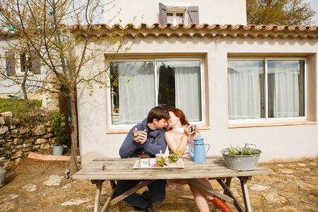 romantic Breakfast together in the open air in the village. honeymoon in Provence, France. tourist trip. the rental home.