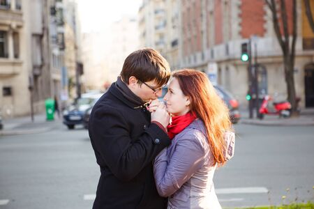 loving couple on a walk in the setting sun. a romantic journey. a man kisses a woman hands.