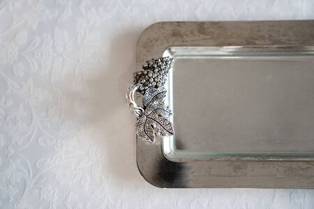 shiny metal handout tray. the design element of the festive table. beautiful tableware. copy space. Banque d'images