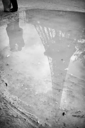 Eiffel tower reflected in a puddle. spring in Paris. the symbol of France. a trip to Europe in the spring. Zdjęcie Seryjne