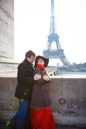 man and woman walking in Paris on the Eiffel tower. a romantic trip in the spring in France.