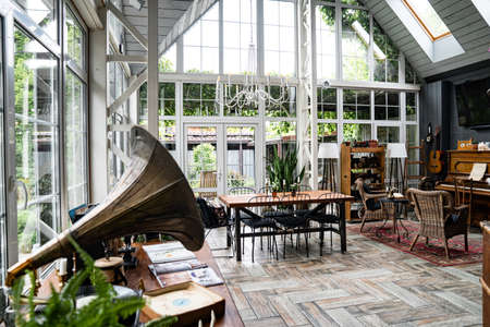 spacious, bright porch with large Windows. place for a family dinner or holiday. retro interior in the vintage style. Foto de archivo