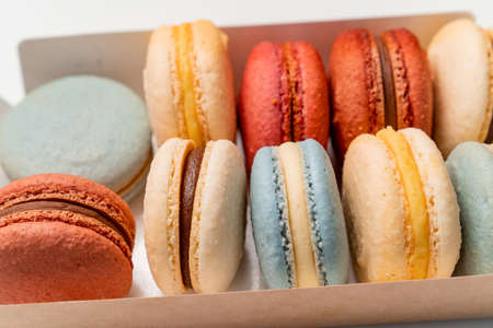 multicolored macarons from natural ingredients and colors in the box. close-up.