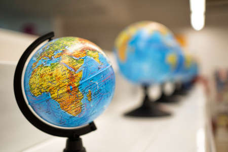 globes on the shelf in the store or in the classroom. the study of geography on the maps. love to travel. protection and ecology of the planet earth. Stock fotó
