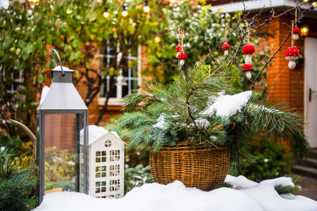 table in yard of a country house with New Years decoration covered with snow