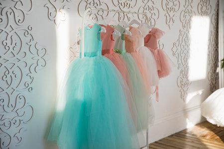 Hanger with colorful elegant puffy dresses for girls. holiday wardrobe. Reklamní fotografie