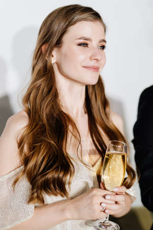 bride with champagne in hands listen to toasts, congratulations from guests Standard-Bild