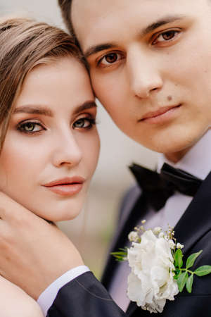 beautiful, gentle and happy bride and groom. man gently touches womans face Standard-Bild