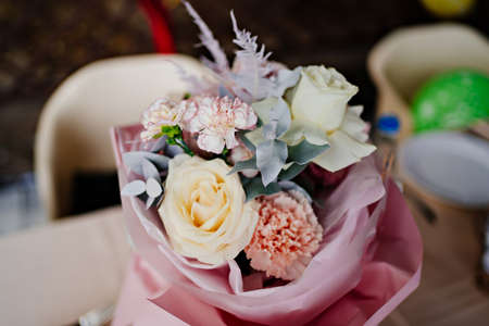 bouquet of the pastel color flowers, yellow, white and pink.roses and carnations