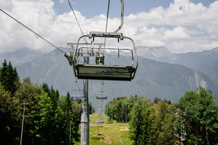 cable car with open trailers in the mountains.