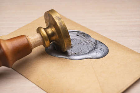 Wax stamp to create a three-dimensional impression.