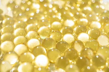 soft yellow gelatine capsules. close-up. pharmaceutical production. Foto de archivo