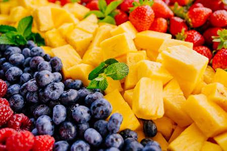 fruit assorted. raspberries, blueberries, pineapple and strawberries