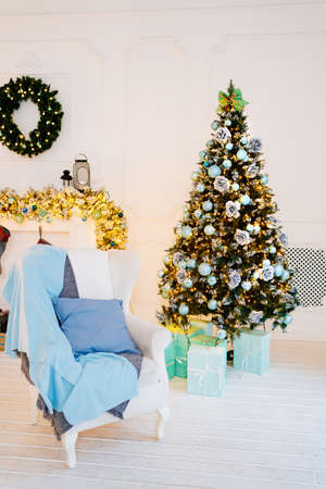 New Year decor of house or photo studio. Christmas tree and decorative fireplace Foto de archivo