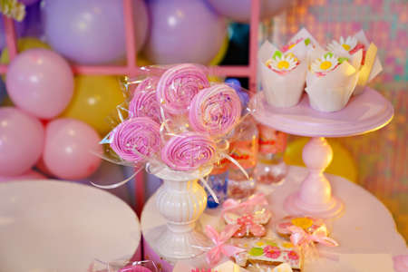 candy bar with sugar flowers on the table. different dessert