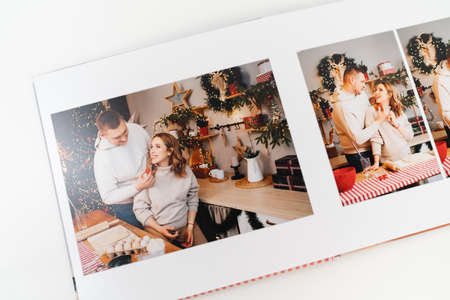page photobook from photo shoot of couple during pregnancy in new years kitchen