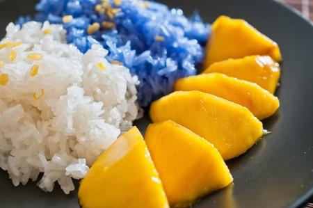 Thai style dessert, glutinous rice with mangoes