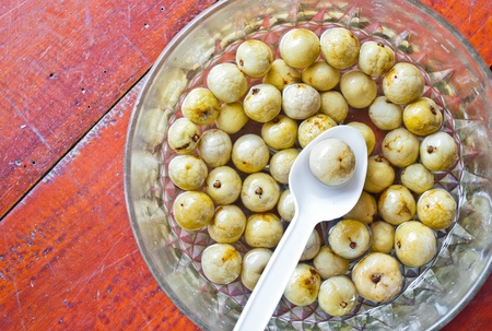 treacle: Group of amla fruits and  treacle sweetmeats Stock Photo