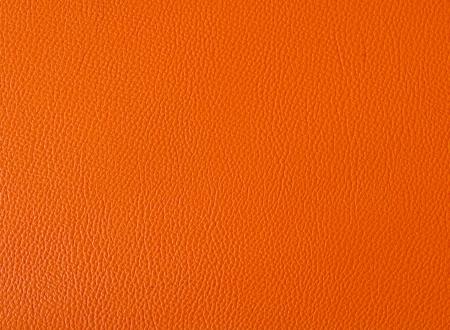オレンジ色の革の背景
