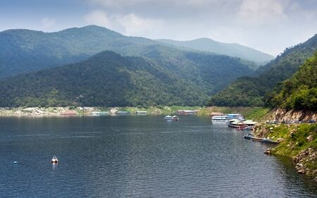 Business travel in the  reservoir on Bhumibol dam area, Thailand photo