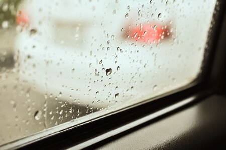 Close up of water drops after rain at the car window photo