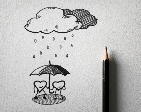 pencil sketching for heart protect the rain concept on white paper
