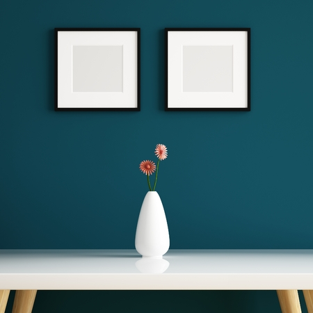 Vase on white table and picture frame decorated Stockfoto
